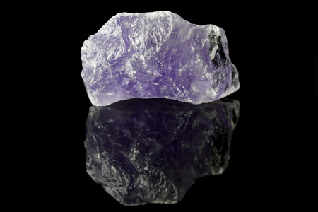Sample of a beautiful natural raw Amethyst specimen over black background Stock Photo
