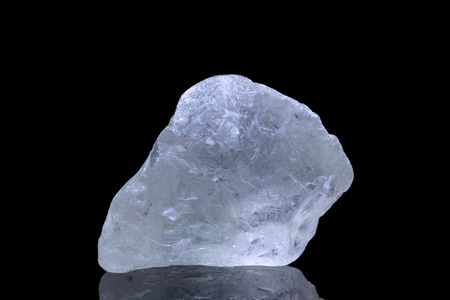 spiritual energy: Sample of a beautiful natural raw blue Topaz specimen over black background Stock Photo