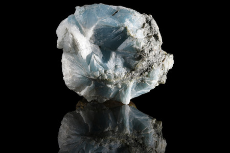 Sample of a beautiful natural raw Larimar specimen over black background Stock Photo