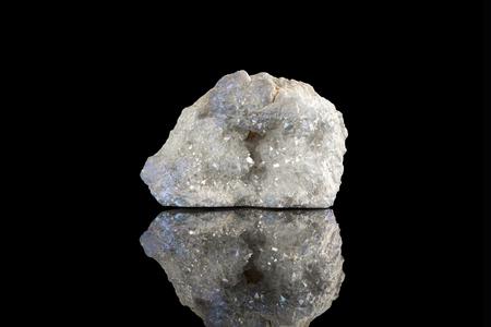 Sample of a beautiful Angel Aura quartz speciment isolated on black  background