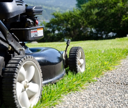 lawn mower close-up next to path