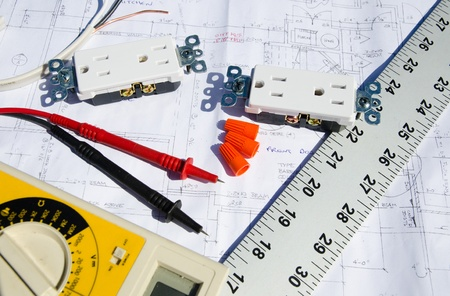 Blue prints with electrical equipment