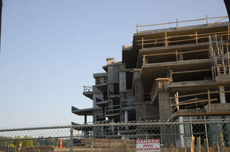 Construction site with safety guard rails, concrete condos
