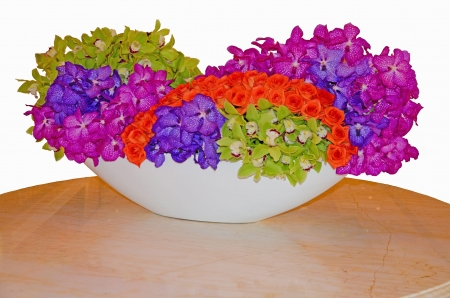 orchid flower display on marble table, vibrant colors