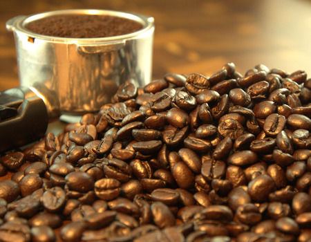 Coffee beans with filter holder, close up