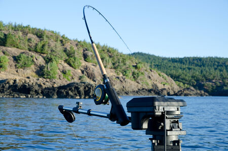 fishing rod with holder on boat