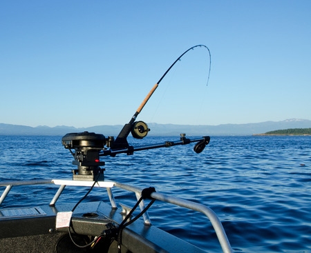 rigger: Fishing Rod with down rigger on bow of boat  Salmon fishing British Columbia