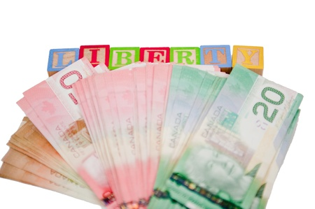 canadian currency: money and blocks symbolizing liberty