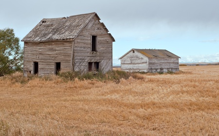 Historic farm house and building on priaire farm land by Calgary, Alberta, Canada photo