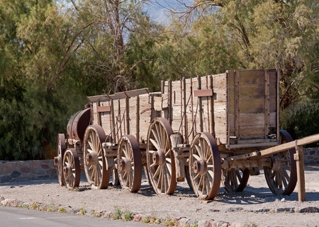 mule train: train of wagons by Death Valley California used for moving goods Stock Photo