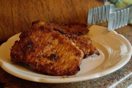 ail: some fried pork steaks