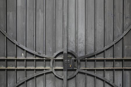 worked: Background gray metal gate worked with lock