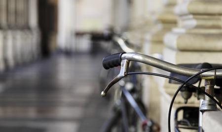 handlebar: Bicycle handlebar over blurred avenue Stock Photo