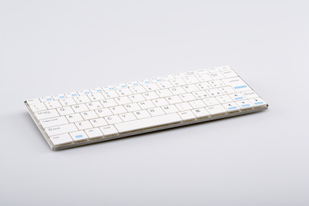 ergonomic keyboard: White portable wireless keyboard for smartphones and tablets Stock Photo