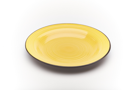 Yellow dinner plate on a white background