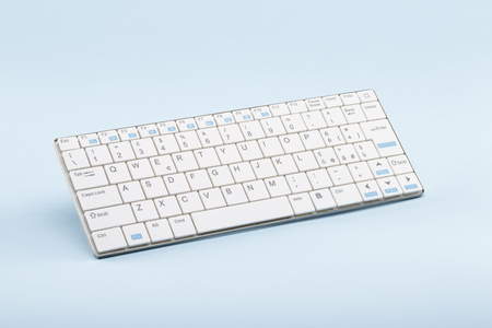 cordiality: White wireless keyboard for tablets and smartphones on celestial background