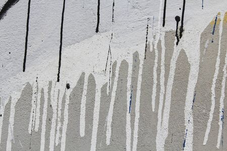 graffito: Background colorful wall with a roller and brush dripping with black and white Stock Photo