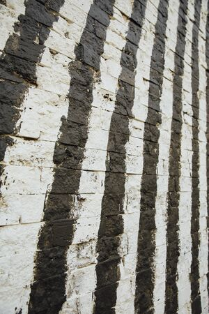 graffito: Background white brick wall painted black stripes with brush and roller Stock Photo