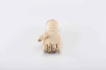 frienship: Wooden hand turned up on a gray background