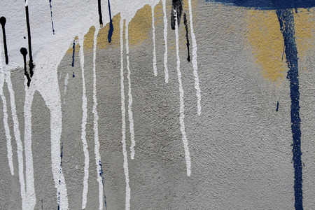 graffito: Background concrete wall painted white and colored with roller and brush for artists with creativity