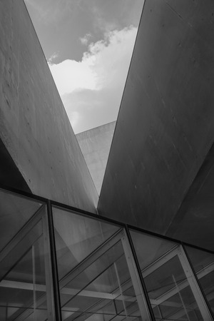 Wall angular concrete building with windows black and white photography