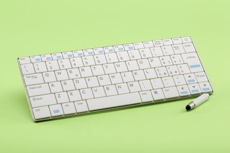 stylus pen: White keyboard and stylus pen Stock Photo
