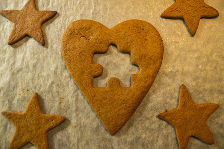 gingerbread heart: The missing piece - Gingerbread heart jigsaw-puzzle Stock Photo