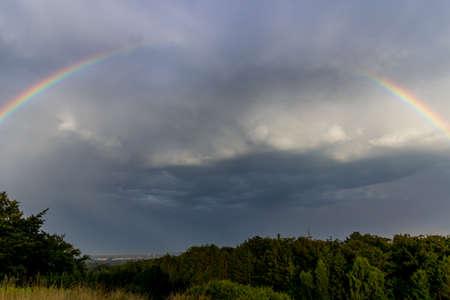 bad color: A broken rainbow and threatening dark clouds.