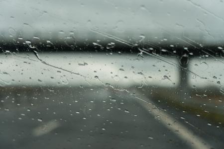 Driving under a bridge on a rainy day