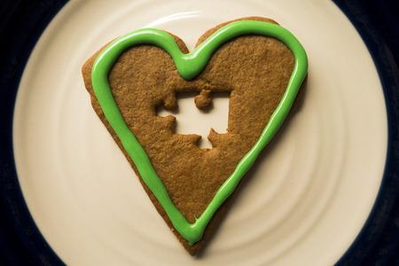 A cinnamon heart with a jigsaw-puzzle piece mising Reklamní fotografie