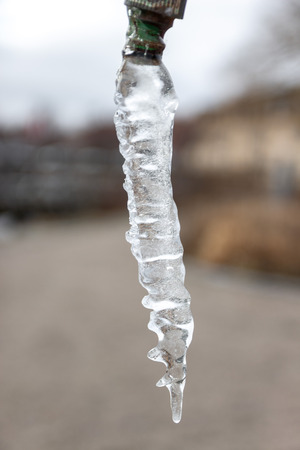 Close-up of icicle hanging from a tap Reklamní fotografie