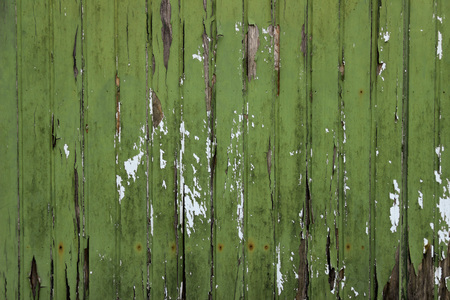 Old green plank wall with flaking paint Reklamní fotografie