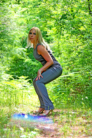 appeared: The beautiful young girl goes around the city, there was a hot weather, the young girl appeared in the wonderful wood Stock Photo