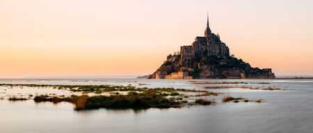 Le Mont Saint-Michel during high tide on sunset Stock Photo