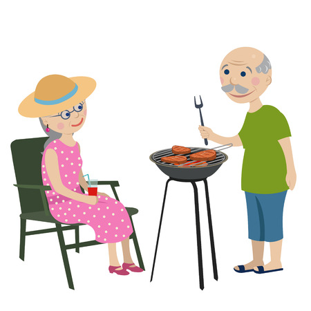 Happy grandparents fry steaks on a barbecue