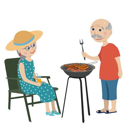 Abuelos felices fritan salchichas en una barbacoa