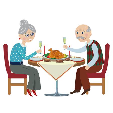 Szczęśliwi starsi ludzie przy boże narodzenie stołem.