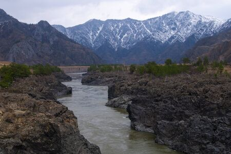 muddy river on a background of mountains 写真素材 - 138837600