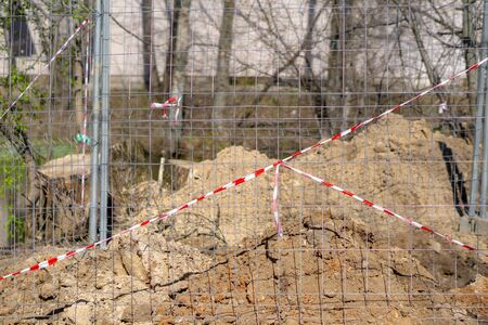 boundary net and band to prevent access to the excavation site