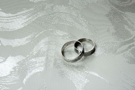 fiance: Two wedding rings made of white gold on decorated cloth