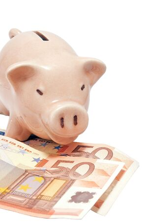 Pink piggy bank with paper euro banknotes photo