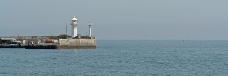 Small lighthouse on the pier in the Yalta bunch. photo