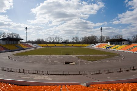 Empty sport stadium with blue sky at background photo