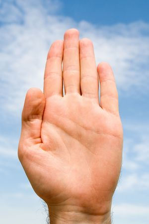 oath: oath. hand gesture with blue sky at background Stock Photo