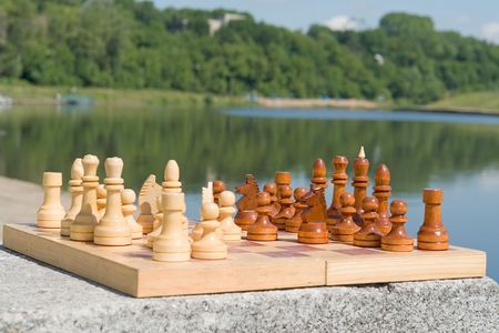 the chessboard with figures with river at background Stock Photo - 1118498
