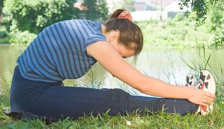 Woman is trained on a riverside Stock Photo - 1118507