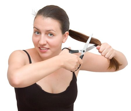 careless: The young woman cuts off the hair on a white background Stock Photo