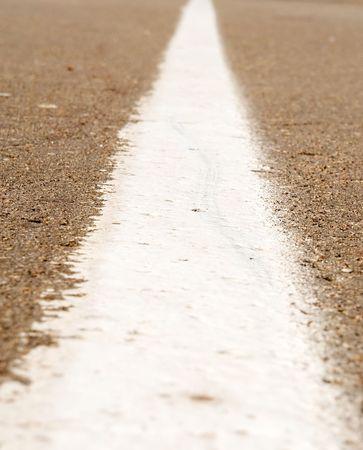 demarcation: asphalt road. white demarcation strip.