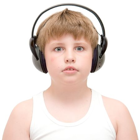 little boy in headphones listens to music