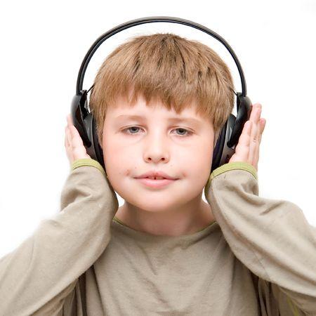 little boy in headphones listens to music photo